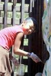 Applying non-toxic linseed oil sealer to Kamalani Kai Bridge and Kamalani Playground is a recurring volunteer activity.